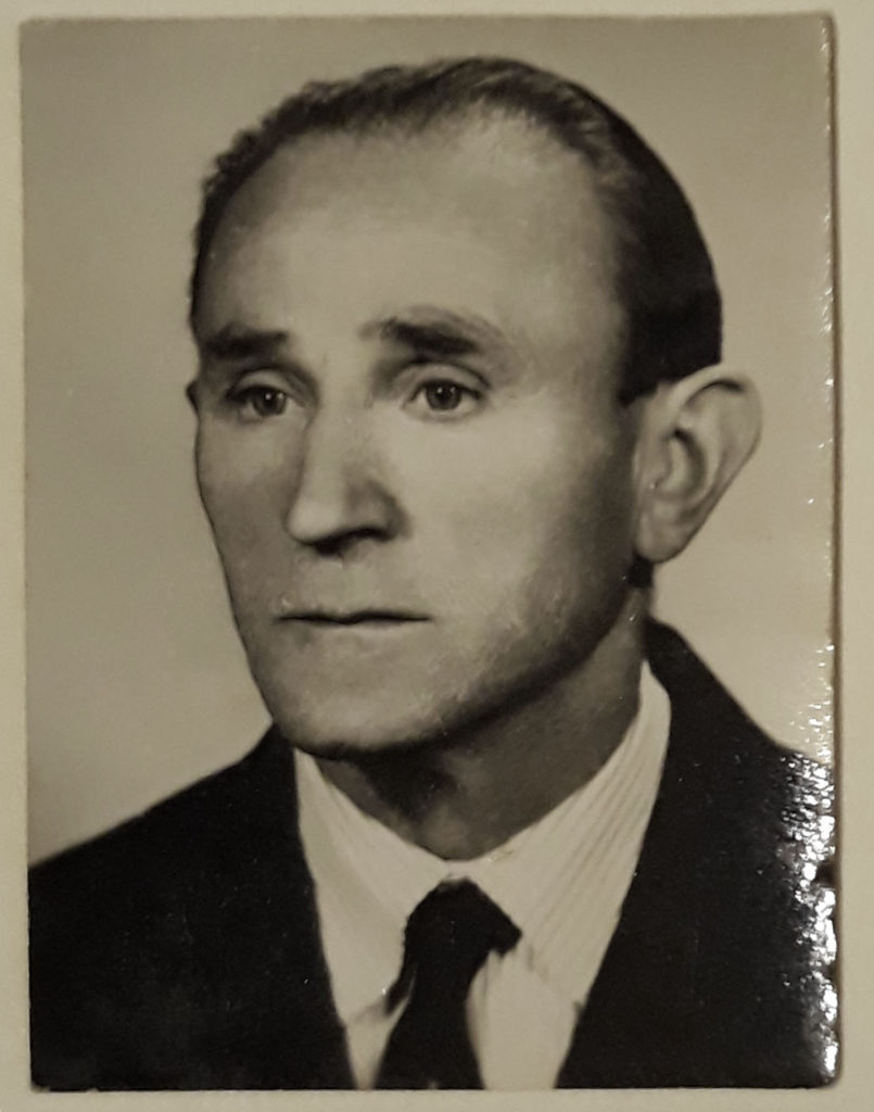 Portrait von Jan G. mit Krawatte und dunklem Anzug.