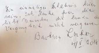 Hand written note by Barbara Lorber in the Axelrodt community house's guest book. It is written in German and states: A unique experience to be here. I thank all those wonderful people who make sure the past is not forgotten.